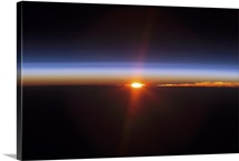 Layers of Earths atmosphere brightly colored as the sun sets over South America