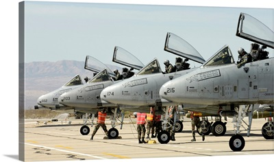 Maintainers perform preflight inspections on A10 Thunderbolt IIs