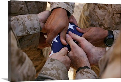 Marines fold an American flag