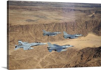 Military planes flying over the Wadi Rum desert in Jordan