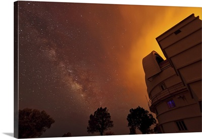 Milky Way appears through smoke over the McDonald Observatory
