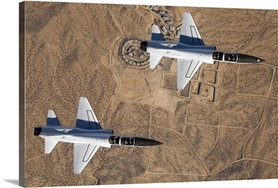 NASA Drydens two T38A mission support aircraft fly in tight formation