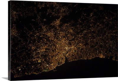 Nighttime image of Portugal showing city lights of Porto and Vila de Gaia