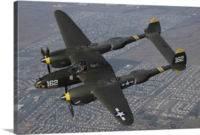 P-38 Lightning flying over Chino, California