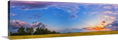Panorama of a colorful sunset over a prairie in Alberta, Canada