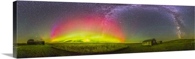 Panorama of an aurora and the Milky Way at a ranch in Canada
