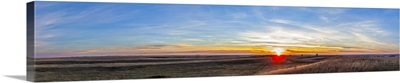Panoramic view of the rising harvest moon and setting Sun, Alberta, Canada