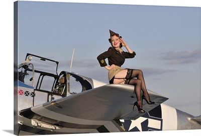Pin-up girl sitting on the wing of a P-51 Mustang