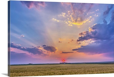 Prairie sunset with crepuscular rays in Alberta, Canada