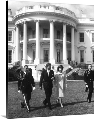 President John F. Kennedy and the First Lady in front of White House