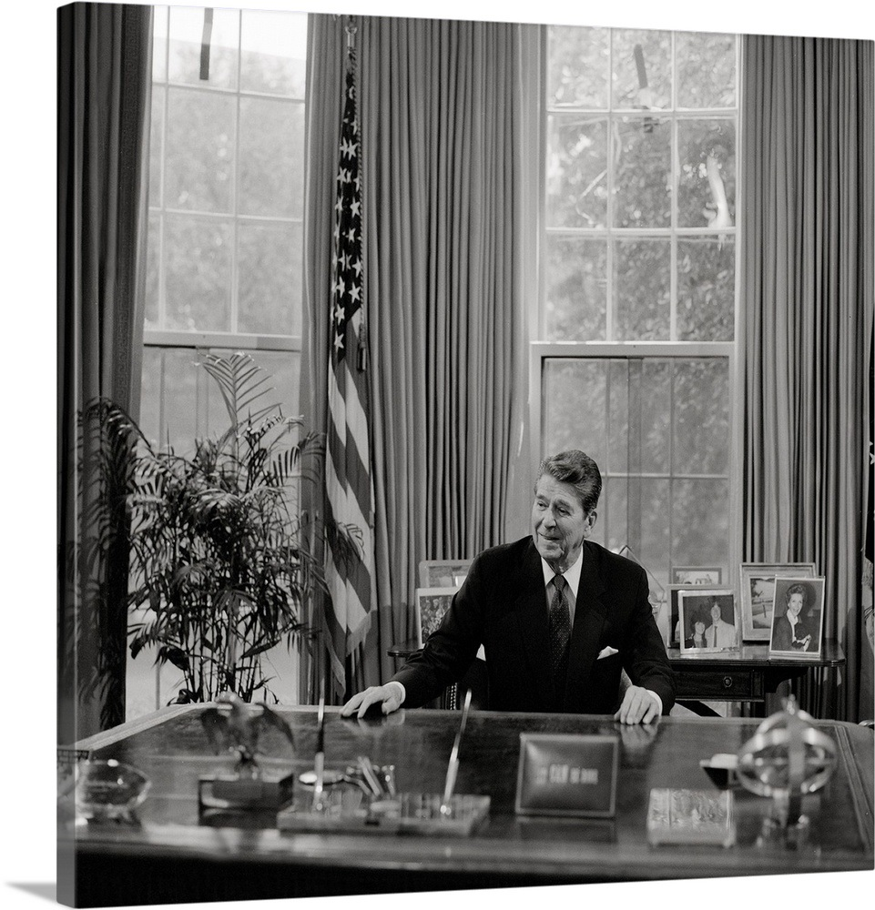 President Ronald Reagan At His Desk In The White House Oval Office