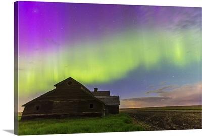 Purple aurora over an old barn in southern Alberta, Canada
