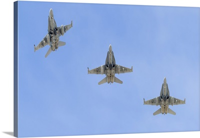 Royal Australian Air Force F/A-18A Hornets break overhead