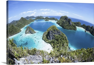 Rugged limestone islands surround a gorgeous lagoon in Raja Ampat
