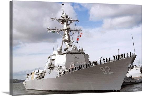 Sailors man the rails aboard the guidedmissile destroyer USS Momsen