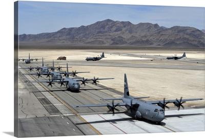Seven C-130J Super Hercules taxiing at Creech Air Force Base