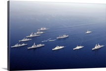 Ships and Rigid Hull Inflatable Boats assemble in formation