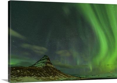 Spectacular northern lights over Mount Kirkjufell in Iceland