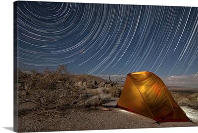 Star trails above a campsite in Anza Borrego Desert State Park, California