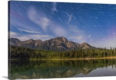 Star trails over Patricia Lake and Pyramid Mountain in, Alberta, Canada