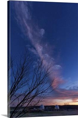 Strange cloud over observatories at sunset