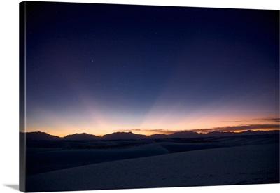 Sunset landscape depicting crepuscular rays