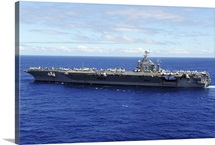 The aircraft carrier USS Abraham Lincoln transits across the Pacific Ocean