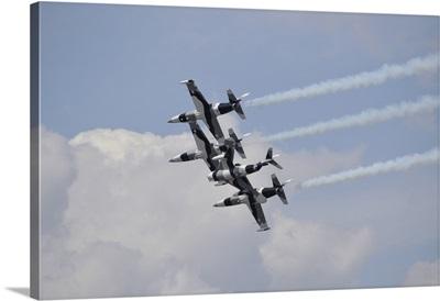 The Black Diamond Jet Team fly in diamond formation