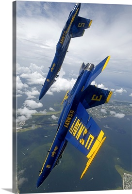 The Blue Angels perform a looping maneuver over Pensacola Beach, Florida