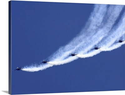 The Blue Angels performing a line abreast loop during an air show