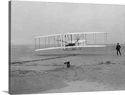 The first flight of the Wright Flyer in 1903