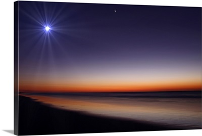The Moon and Venus at twilight from the beach of Pinamar, Argentina