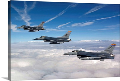 Three F-16s fly in formation during a training mission over Arizona