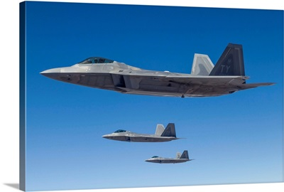 Three U.S. Air Force F-22 Raptors cruise above Nevada