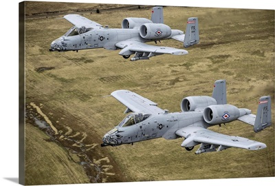 Two A-10 Thunderbolt II's conduct a training mission over Arkansas