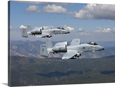 Two A-10 Thunderbolts fly over the mountains in Central Idaho