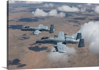 Two A-10 Thunderbolts fly over the Saylor Creek bombing range, Idaho