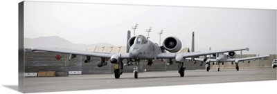 Two A10 Thunderbolts taxi out to the runway