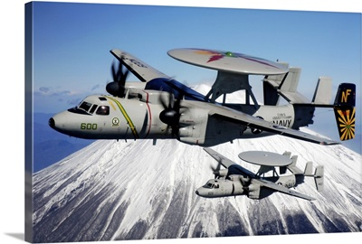 Two E2C Hawkeyes conduct a flyby of Mount Fuji in Japan