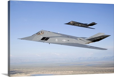 Two F-117 Nighthawk stealth fighters in flight over New Mexico