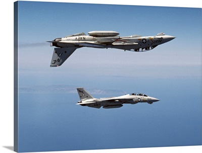 Two F-14A Tomcats perform aerobatics above the Pacific Ocean