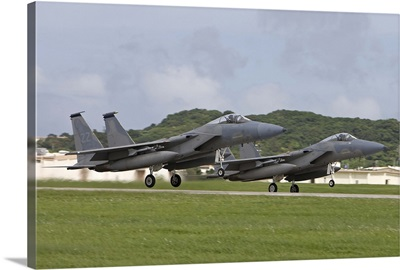 Two F-15 Eagles take off in formation from Kadena Air Base, Japan