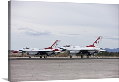 Two F-16C Thunderbirds sit on the runway at Nellis Air Force Base, Nevada