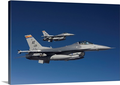 Two F-16s fly in formation over Arizona