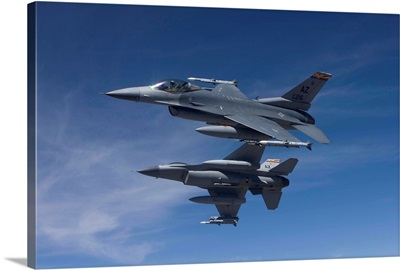 Two F-16s manuever on an air-to-air training mission