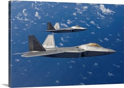 Two F-22 Raptors fly in formation during a training mission
