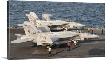 Two F/A-18 Super Hornet aircraft on the flight deck of USS George H.W. Bush
