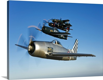 Two Grumman F8F Bearcats and two F7F Tigercats fly in formation