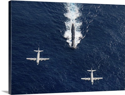 Two P 3 Orion maritime surveillance aircraft fly over attack submarine USS Houston