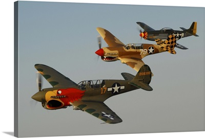 Two P-40 Warhawks and a P-51D Mustang flying over Chino, California